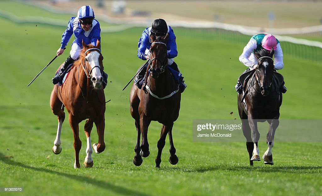 Richard Hills rides Akmal (L) to win the Directa Signs Noel Murless Stakes at Newmarket Racecourse on October 1, 2009 in Newmarket, England.
