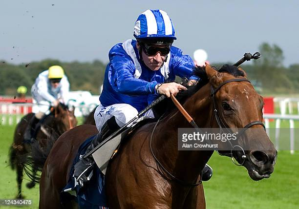 Richard Hills rides Ektihaam on his way to winning The Frank Whittle Partnership Conditions Stakes at Doncaster racecourse on September 09 2011 in...