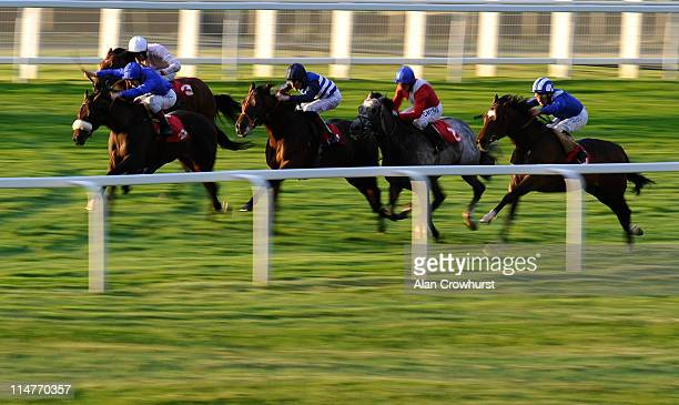 Richard Hills riding Tazahum win The Charles Heidsieck Champagne Heron Stakes at Sandown racecourse on May 26, 2011 in Esher, England.