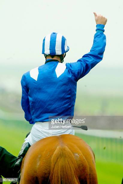 Richard Hills shows his delight after Haffhd landed The ultimatebetcom 2000 Guineas Stakes Race run at Newmarket Racecourse on May 1 2004 in...