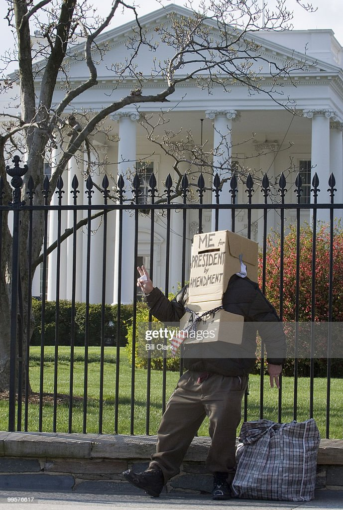 Richard Hohensee waves to parents and children heading to the White House Easter Egg Roll on the South Lawn of the White House on Monday, April 9, 2007. Mr. Hohensee is running for President by Constitutional Amendment, and hopes to have Sen. Russ Feingold as his Vice President.