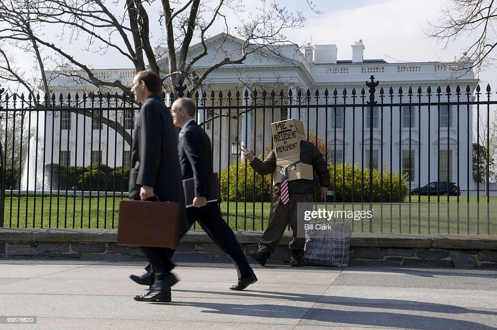Richard Hohensee waves to pedestrians in front of the White House on Monday, April 9, 2007. Mr. Hohensee is running for President by Constitutional Amendment, and hopes to have Sen. Russ Feingold as his Vice President.