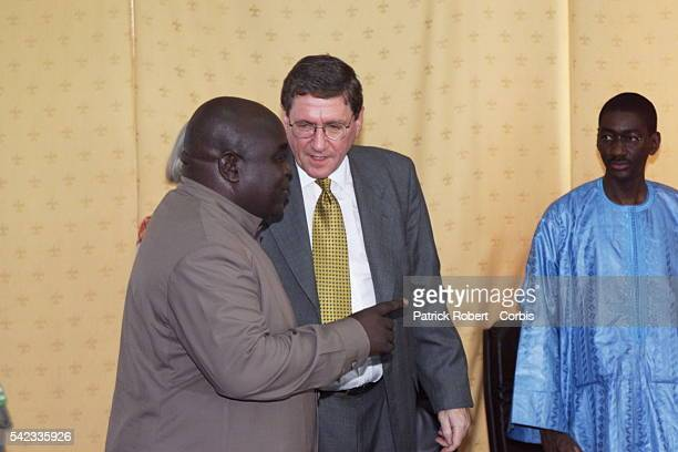 Richard Holbrooke with Laurent Desire Kabila prior to the signature of the SOFA agreement