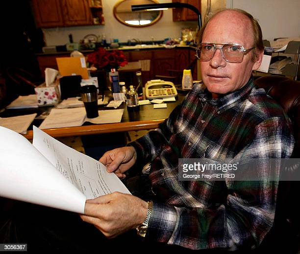 Richard Holm of Colorado City Arizona goes over Lawsuit papers that were just served on him that morning March 3 2004 by the Fundamentalist Church of...