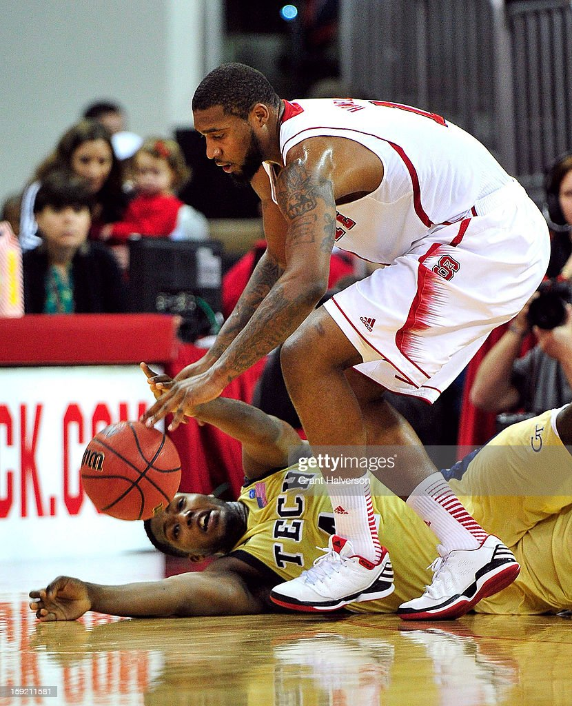 Richard Howell #1 of the North Carolina State Wolfpack battles for a loose ball with Robert Carter Jr. #4 of the Georgia Tech Yellow Jackets during play at PNC Arena on January 9, 2013 in Raleigh, North Carolina.