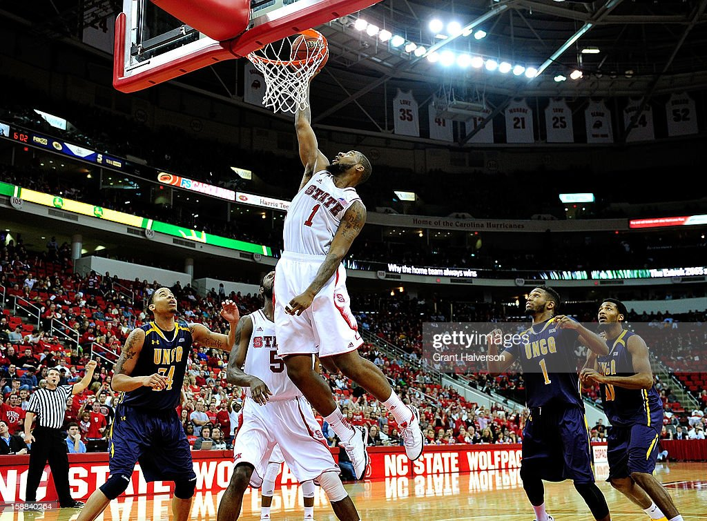 Richard Howell #1 of the North Carolina State Wolfpack dunks a rebound against the UNC Greensboro Spartans during play at PNC Arena on December 31, 2012 in Raleigh, North Carolina. North Carolina State won 89-68.