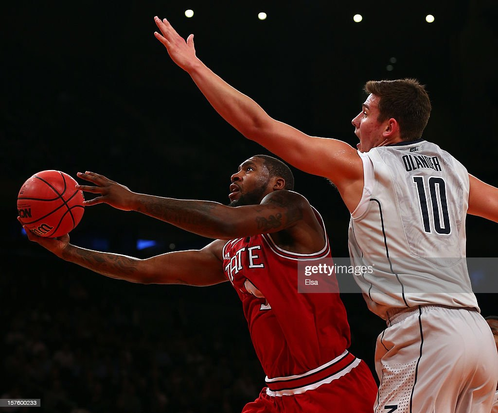 Richard Howell #1 of the North Carolina State Wolfpack heads for the net as Tyler Olander #10 of the Connecticut Huskies defends during the Jimmy V Classic on December 4, 2012 at Madison Square Garden in New York City. The North Carolina State Wolfpack defeated the Connecticut Huskies 69-65.