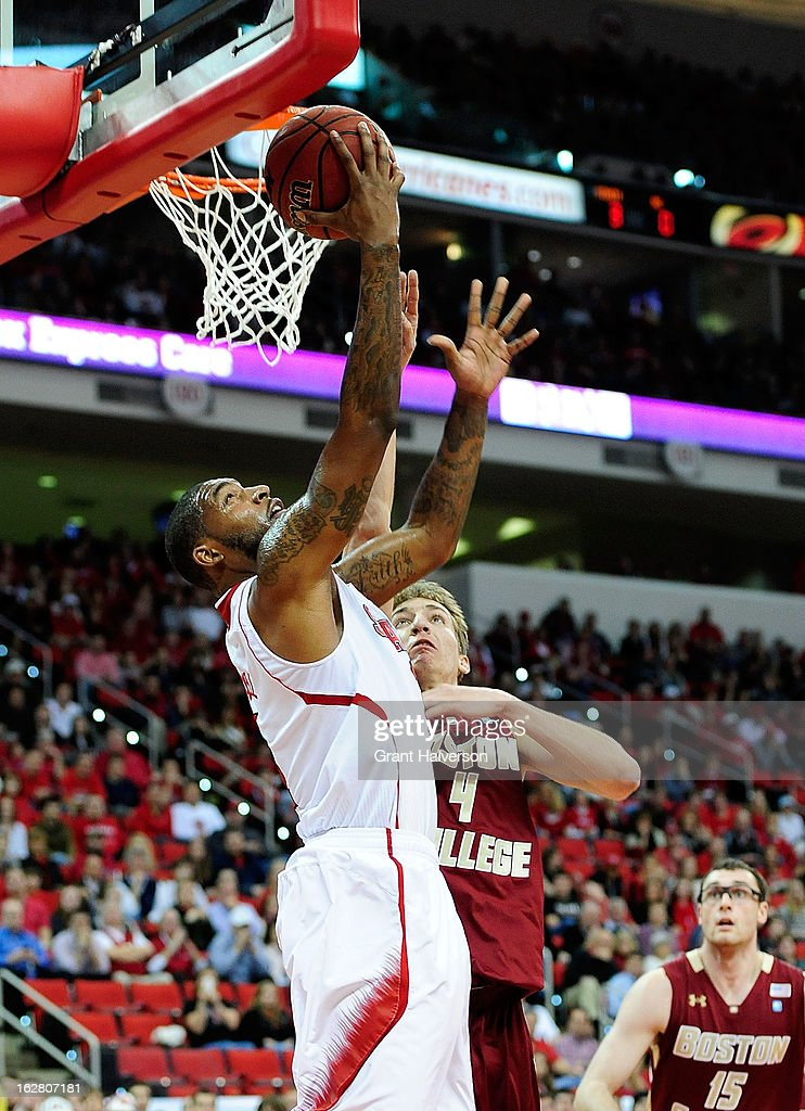 Richard Howell #1 of the North Carolina State Wolfpack scores over Eddie Odio #4 of the Boston College Eagles during play at PNC Arena on February 27, 2013 in Raleigh, North Carolina.