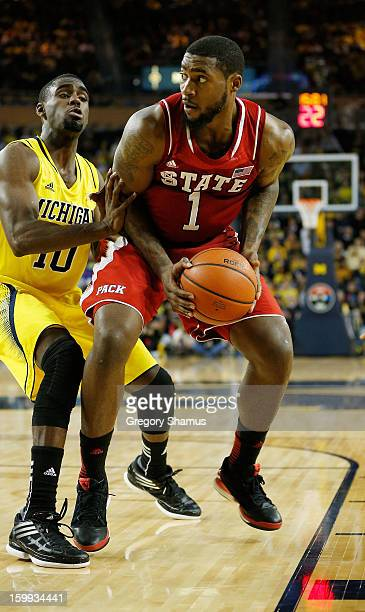 Richard Howell of the North Carolina State Wolfpack shoots over the defense of Tim Hardaway Jr #10 of the Michigan Wolverines at Crisler Center on...