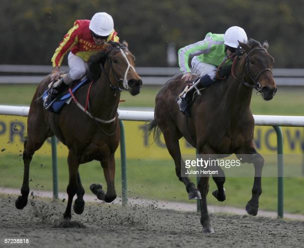 Richard Hughes and Billy Bling get the better of the Alan Munro partnered Bathwick Alice to land The Lingfield Park Golf Club Handicap Stakes Race...