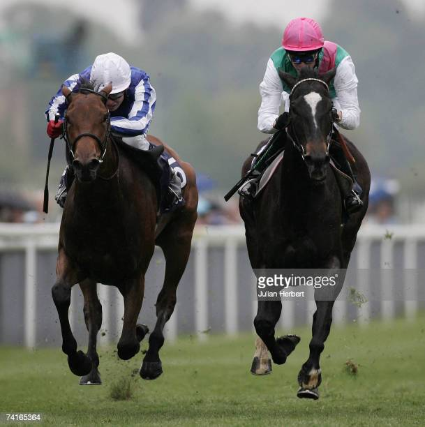 Richard Hughes and Passage Of Time get the better of the Jamie Spencer ridden Sweet Lilly to land The Tattersalls Musidora Stakes Race run at York...
