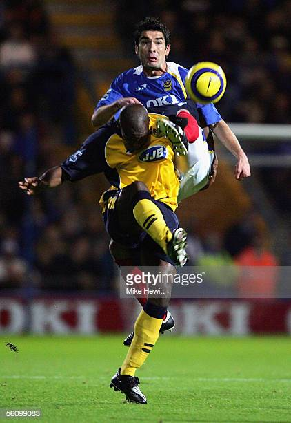 Richard Hughes of Portsmouth rises above Damien Francis of Wigan during the Barclays Premiership match between Portsmouth and Wigan Athletic at...