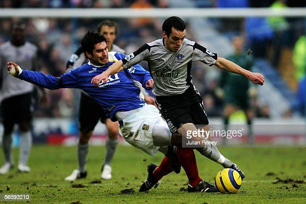 Richard Hughes of Portsmouth slides in on Leon Osman of Everton during the Barclays Premiership match between Portsmouth and Everton at Fratton Park...