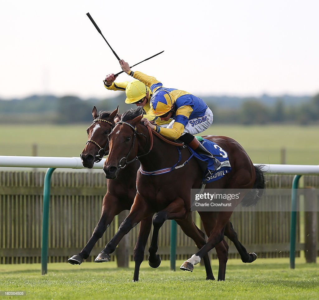 Richard Hughes on Chriselliam beats James Doyle on Rizeena to win The Shadwell Fillies' Mile at Newmarket racecourse on September 27, 2013 in Newmarket, England.