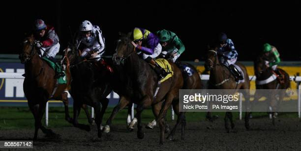 Richard Hughes on Dingaan wins the Mix Business With Pleasure Claiming Stakes with Paul Hanagan in second place on Vhujon at Kempton Park Racecourse