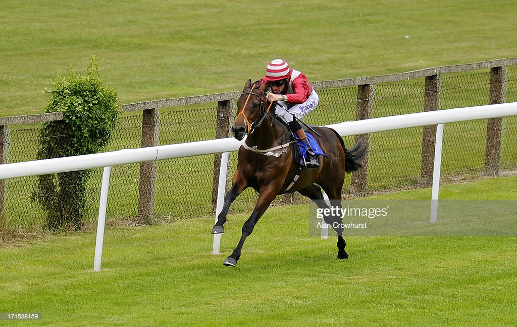 Richard Hughes riding Brown Sugar wins The Westover Jaguar F-Type Maiden Stakes at Salisbury racecourse on June 26, 2013 in Salisbury, England.