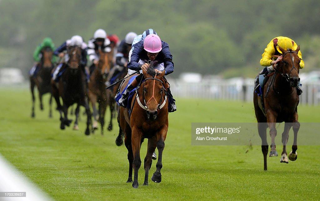 Richard Hughes riding Emperor's Hope win The Glebe Farm Stud Maiden Auction Stakes at Salisbury racecourse on June 11, 2013 in Salisbury, England.