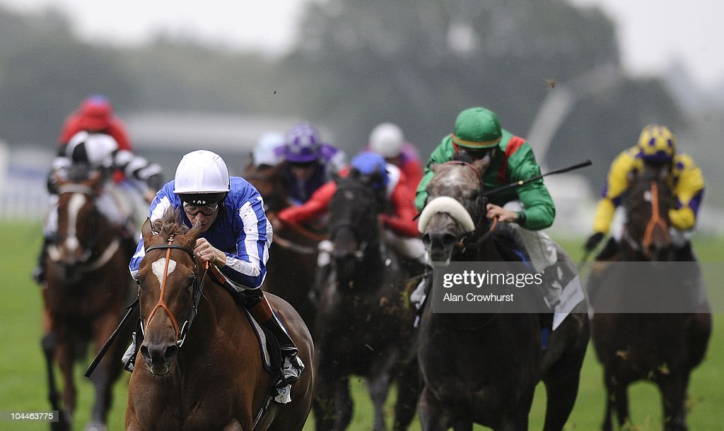Richard Hughes riding Lady of The Desert win The John Guest Diadem Stakes at Ascot racecourse on September 26, 2010 in Ascot, England