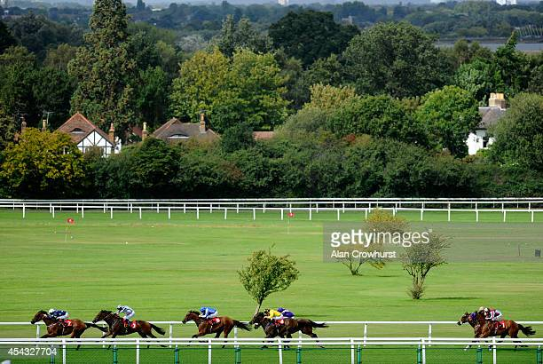 Richard Hughes riding Macdillon win The Sports Taster Day Handicap Stakes at Sandown racecourse on August 29 2014 in Esher England