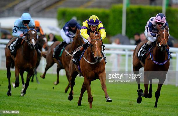 Richard Hughes riding Our Queenie win The Goodwood Maiden Auction Stakes at Goodwood racecourse on May 24 2013 in Chichester England