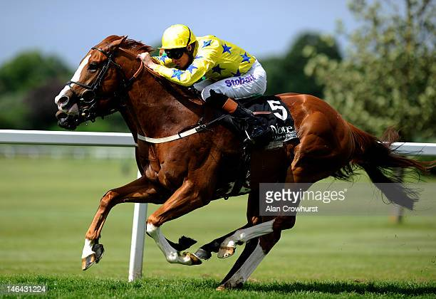 Richard Hughes riding Pearl Secret win The Novae Bloodstock Insurance Scurry Stakes at Sandown racecourse on June 16 2012 in Esher England