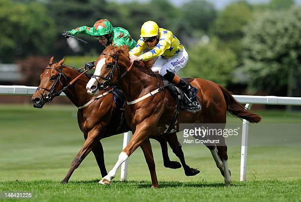 Richard Hughes riding Pearl Secret win The Novae Bloodstock Insurance Scurry Stakes from Free Zone at Sandown racecourse on June 16 2012 in Esher...