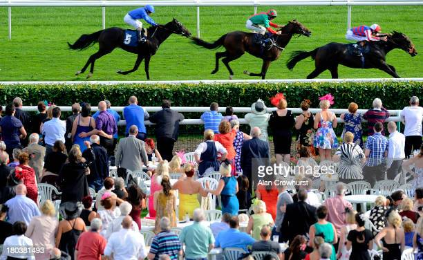 Richard Hughes riding Pupil win The crownhotelbawtrycom EBF Maiden Stakes at Doncaster racecourse on September 12 2013 in Doncaster England
