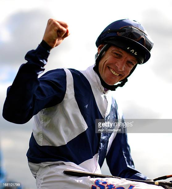Richard Hughes riding Sky Lantern celebrates after winning The Qipco 1000 Guineas Stakes at Newmarket racecourse on May 05 2013 in Newmarket England