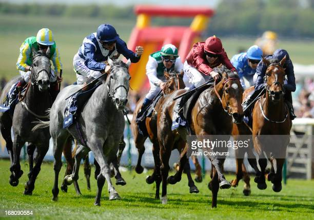Richard Hughes riding Sky Lantern celebrates winning The Qipco 1000 Guineas Stakes from Just The Judge at Newmarket racecourse on May 05 2013 in...