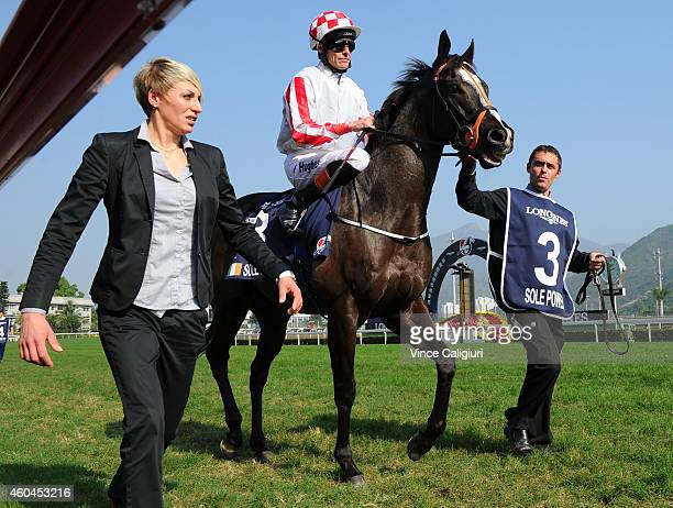 Richard Hughes riding Sole Power heads to the start of Race 5 The LONGINES Hong Kong Sprint during International Race day at Sha Tin racecourse on...