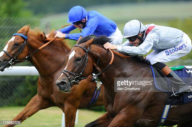 Richard Hughes riding Toronado win The Qipco Sussex Stakes from Dawn Approach at Goodwood racecourse on July 31 2013 in Chichester England