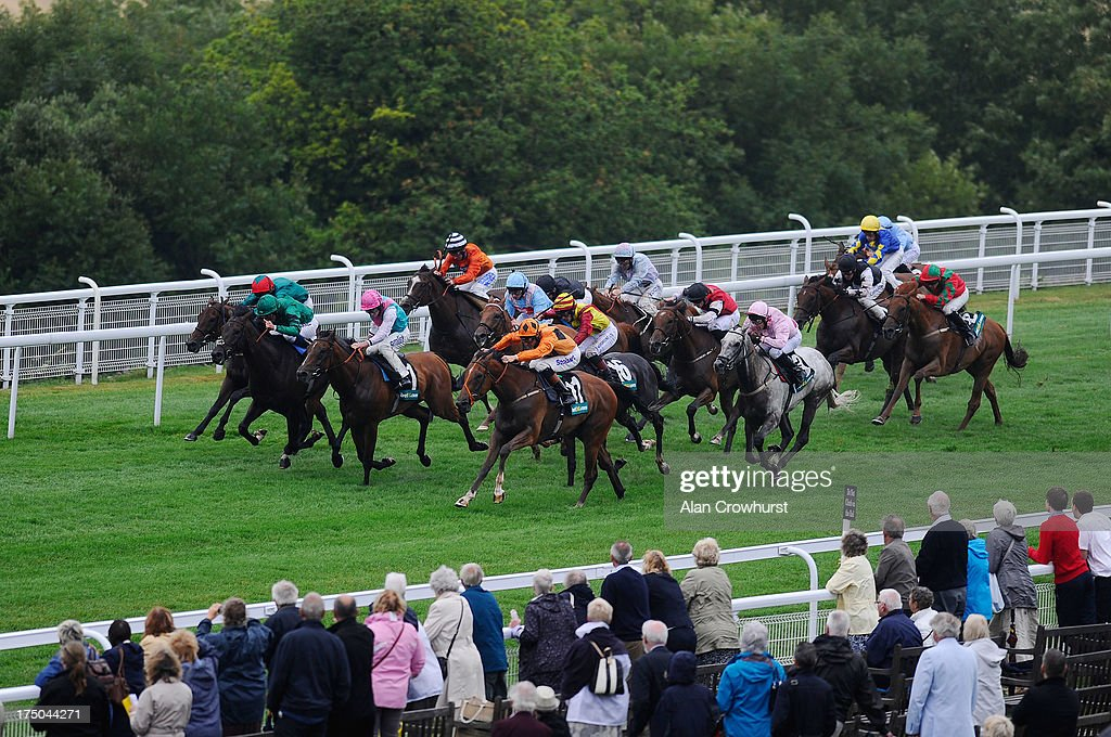 Richard Hughes riding Viewpoint (R, orange) win The bet365.com Stakes at Goodwood racecourse on July 30, 2013 in Chichester, England.