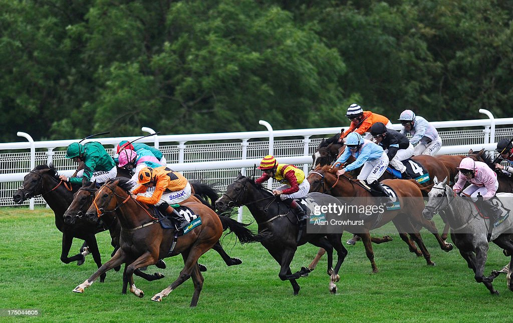 Richard Hughes riding Viewpoint (L, orange) win The bet365.com Stakes at Goodwood racecourse on July 30, 2013 in Chichester, England.