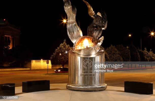 Richard Hunt's The 'Eternal Flame Of Hope', which symbolizes the Special Olympics' theme of inclusion and unity as well as hope, stands outside...