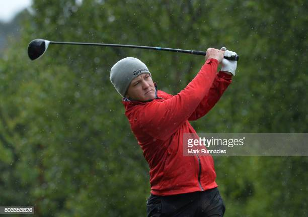 Richard James of Wales plays his tee shot in the cold and wet conditions at the 5th hole during the first day of the 2017 SSE Scottish Hydro...