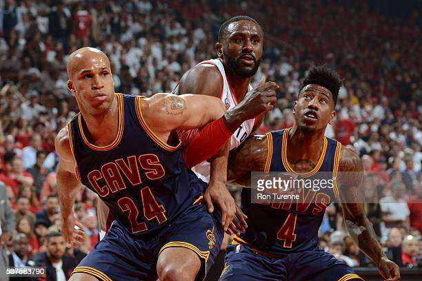 Richard Jefferson and Iman Shumpert of the Cleveland Cavaliers box out Patrick Patterson of the Toronto Raptors during Game Six of the NBA Eastern...