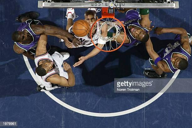 Richard Jefferson and Jason Collins of the New Jersey Nets battle Ervin Johnson Tim Thomas and Desmond Mason of the Milwaukee Bucks under the basket...