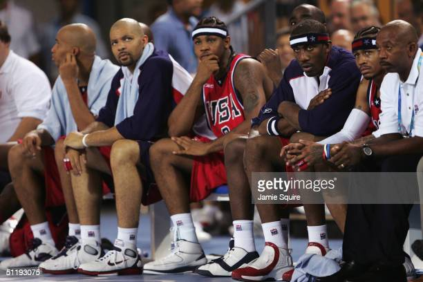 Richard Jefferson, Carlos Boozer, Carmelo Anthony, Amare Stoudemire and Allen Iverson of the United States sit stoically on the bench in the men's...