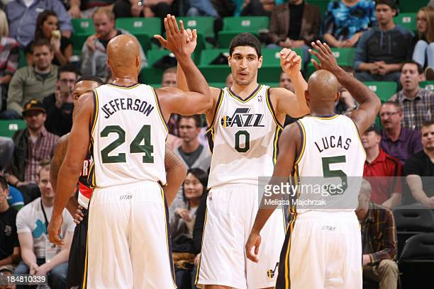 Richard Jefferson, Enes Kanter, and John Lucas III of the Utah Jazz celebrate during play against the Portland Trail Blazers at Energy Solutions...