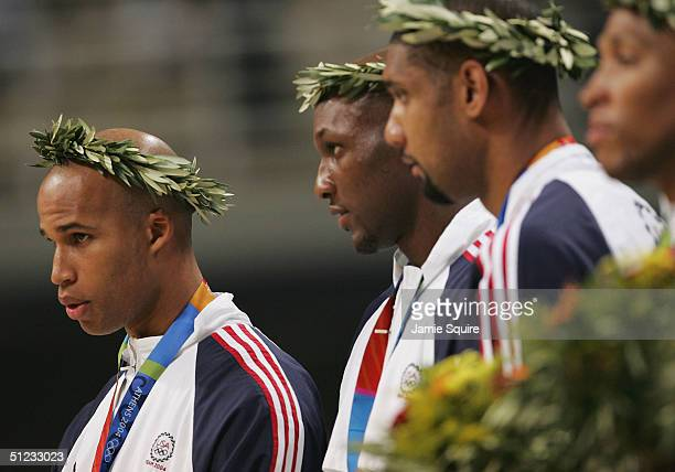 Richard Jefferson Lamar Odom and Tim Duncan of the United States receive the bronze medal in the men's basketball during ceremonies on August 28 2004...