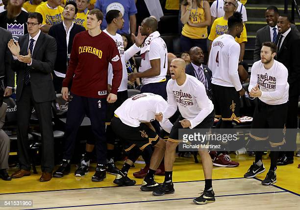 Richard Jefferson of the Cleveland Cavaliers and the bench react to a play against the Golden State Warriors in Game 7 of the 2016 NBA Finals at...