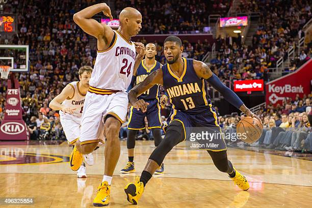 Richard Jefferson of the Cleveland Cavaliers defends Paul George of the Indiana Pacers during the first half at Quicken Loans Arena on November 8...