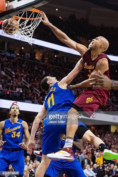 Richard Jefferson of the Cleveland Cavaliers dunks over Klay Thompson of the Golden State Warriors during the second half at Quicken Loans Arena on...