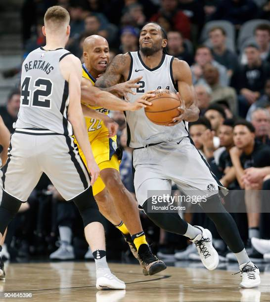 Richard Jefferson of the Denver Nuggets tries to get thru a Davis Bertans of the San Antonio Spurs screen to steal the ball from Kawhi Leonard of the...