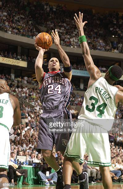 Richard Jefferson of the New Jersey Nets attempts a shot over Paul Pierce of the Boston Celtics on May 31 2002 during the 2002 NBA Eastern Conference...