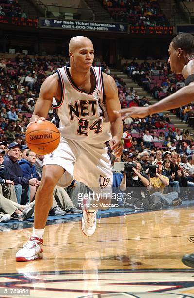 Richard Jefferson of the New Jersey Nets dribble drives to the basket against the Miami Heat during the game at the Continental Airlines Arena on...