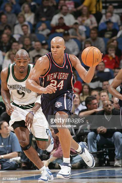 Richard Jefferson of the New Jersey Nets dribbles the ball down the court against Justin Reed of the Minnesota Timberwolves during the game on March...