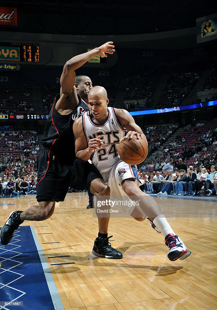 Richard Jefferson of the New Jersey Nets drives against Andre ... a5bbf0354