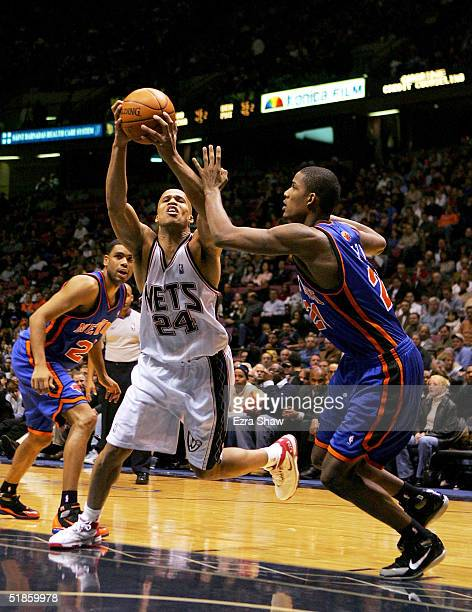 Richard Jefferson of the New Jersey Nets drives on Trevor Ariza of the New York Knicks on December 14 2004 at Continental Airlines Arena in East...