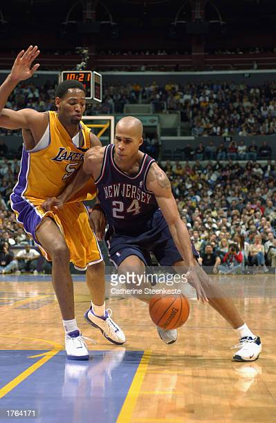 Richard Jefferson of the New Jersey Nets drives to the basket against Robert Horry of the Los Angeles Lakers during the NBA game at Staples Center on...